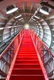 Concepto acertado de la escalera roja Imagen de archivo libre de regalías