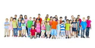 Concepto alegre alegre de los niños grandes del grupo Foto de archivo libre de regalías