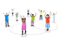 Concepto alegre de la comunidad de la niñez de los niños del grupo Foto de archivo libre de regalías