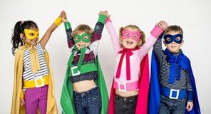 Concepto alegre del traje de los superhéroes de los niños Foto de archivo