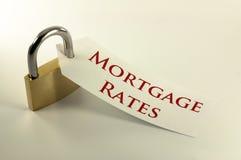 Concepto bloqueado de las tarifas de hipoteca abajo Foto de archivo