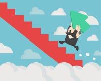 Concepto de éxito, hombre de negocios acertado que sostiene una flecha verde Fotografía de archivo