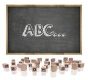 Concepto de ABC en la pizarra con el marco de madera y Fotos de archivo libres de regalías