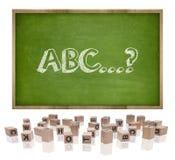 Concepto de ABC en la pizarra con el marco de madera y Fotografía de archivo