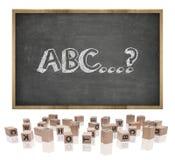Concepto de ABC en la pizarra con el marco de madera y Fotos de archivo