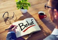 Concepto de Brainstorming About Belief del hombre de negocios imágenes de archivo libres de regalías