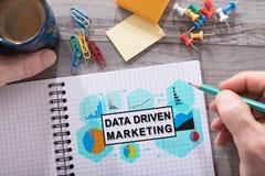 Concepto de comercialización conducido datos en una libreta fotografía de archivo