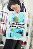 Concepto de comercialización conducido datos mostrado por un hombre de negocios imágenes de archivo libres de regalías