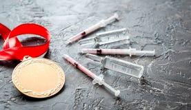 Concepto de doping en el deporte - medallas de la privación imagen de archivo