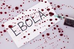 Concepto de Ebola con una jeringuilla llenada sangre Imágenes de archivo libres de regalías