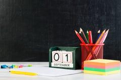 Concepto de educación, primer de septiembre o de nuevo a la escuela w Foto de archivo libre de regalías
