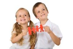 Concepto de familia feliz con los cabritos Imagen de archivo