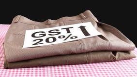 Concepto de GST para la ropa confeccionada Imagen de archivo