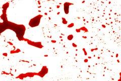 Concepto de Halloween: Salpicadura de la sangre en el fondo blanco foto de archivo libre de regalías