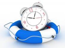 Concepto de hora de ser seguro. Despertador con la boya de vida Imagen de archivo
