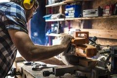 Concepto de la artesanía en madera de Craftman Lumber Timber del carpintero imágenes de archivo libres de regalías