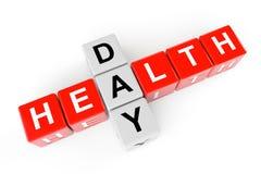Concepto de la atención sanitaria. Cubos con la muestra del día de la salud Foto de archivo libre de regalías