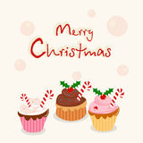 Concepto de la celebración de la Feliz Navidad con las tortas de la taza Foto de archivo