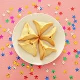 Concepto de la celebración de Purim y x28; holiday& judío x29 del carnaval; Tradicional hamantaschen las galletas Visión superior Imágenes de archivo libres de regalías