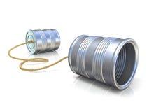 Concepto de la comunicación: teléfono de los niños de la lata con la cuerda Imagen de archivo