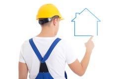 Concepto de la construcción - hombre en el aislador de la casa del dibujo del uniforme del constructor Fotos de archivo