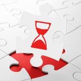 Concepto de la cronología: Reloj de arena en fondo del rompecabezas Imagen de archivo