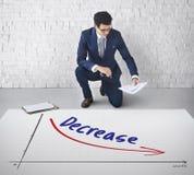 Concepto de la disminución del fracaso del riesgo financiero de la recesión Foto de archivo