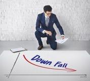 Concepto de la disminución del fracaso del riesgo financiero de la recesión Fotos de archivo