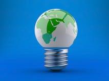 Concepto de la energía. Bombilla con tierra del planeta Imagen de archivo libre de regalías
