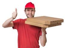 Concepto de la entrega de la pizza El muchacho joven está entregando la pizza en cajas Imagen de archivo libre de regalías