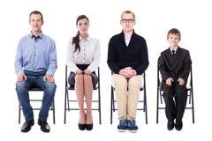 Concepto de la entrevista y de la carrera - hombres de negocios jovenes y uno encendidos imagen de archivo
