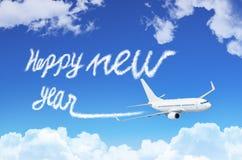 Concepto de la Feliz Año Nuevo Dibujo por la estela de vapor del vapor del aeroplano en cielo Imagenes de archivo