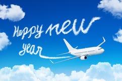Concepto de la Feliz Año Nuevo Dibujo por la estela de vapor del vapor del aeroplano en cielo Foto de archivo libre de regalías