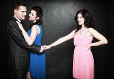 Concepto de la infidelidad marital. Odio de la pasión del triángulo de amor Imágenes de archivo libres de regalías
