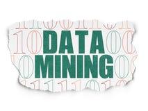 Concepto de la información: Minería de datos en el papel rasgado Foto de archivo