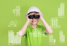 Concepto de la ingeniería de construcción de las propiedades inmobiliarias Muchacho lindo con bino Imágenes de archivo libres de regalías