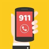Concepto de la llamada de emergencia 911 Mano que sostiene el teléfono móvil Foto de archivo libre de regalías