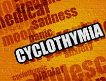 Concepto de la medicina: Cyclothymia en la pared de ladrillo amarilla Foto de archivo libre de regalías