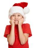 Concepto de la Navidad de las vacaciones de invierno - muchacho en el retrato del sombrero de santa en blanco aislado Fotografía de archivo