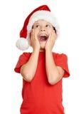 Concepto de la Navidad de las vacaciones de invierno - muchacho en el retrato del sombrero de santa en blanco aislado Imagen de archivo