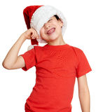 Concepto de la Navidad de las vacaciones de invierno - muchacho en el retrato del sombrero de santa en blanco aislado Fotografía de archivo libre de regalías
