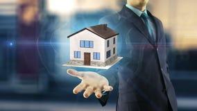Concepto de la nueva casa del hombre de negocios stock de ilustración