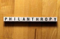 Concepto de la palabra de la filantropía fotografía de archivo
