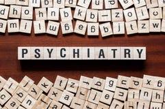 Concepto de la palabra de la psiquiatría en los cubos fotografía de archivo