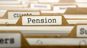 Concepto de la pensión con palabra en carpeta Foto de archivo libre de regalías