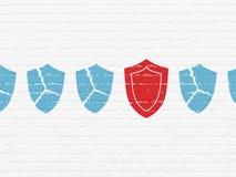 Concepto de la protección: icono del escudo en fondo de la pared Foto de archivo libre de regalías
