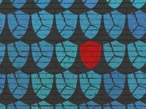 Concepto de la protección: icono del escudo en fondo de la pared Fotografía de archivo libre de regalías