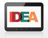 Concepto de la publicidad: Ordenador de la PC de la tableta con idea en la exhibición Imagenes de archivo