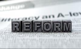 Concepto de la reforma, texto de los dados foto de archivo