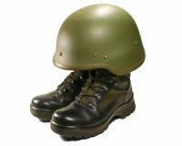 Concepto de la representación visual del soldado. Cargadores del programa inicial y casco militares. Fotos de archivo
